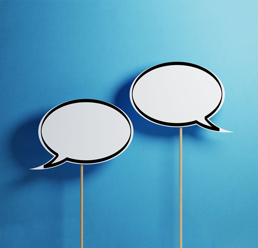 speech bubbles on sticks with blue background
